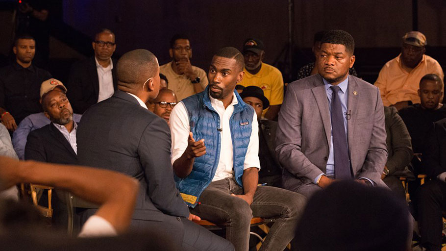 Carlos Watson sits with civil rights activist DeRay Mckesson and professor and journalist D. Watkins for Take On America in Baltimore on Oct. 8, 2018.