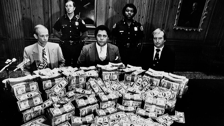 Maynard Jackson in 1981 posing with reward money offered for information on the Atlanta child murders.