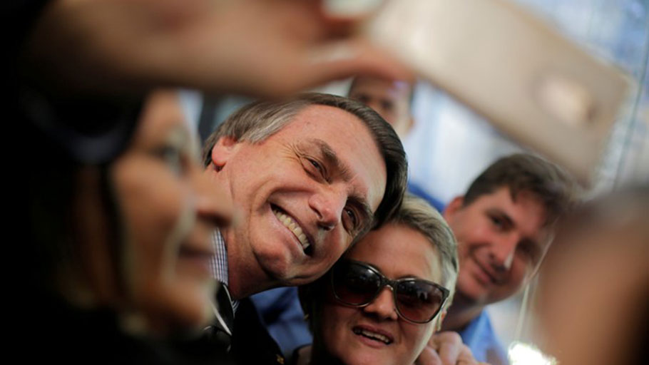 Presidential candidate Jair Bolsonaro poses for picture at the National Congress in Brasília, Brazil, in September.