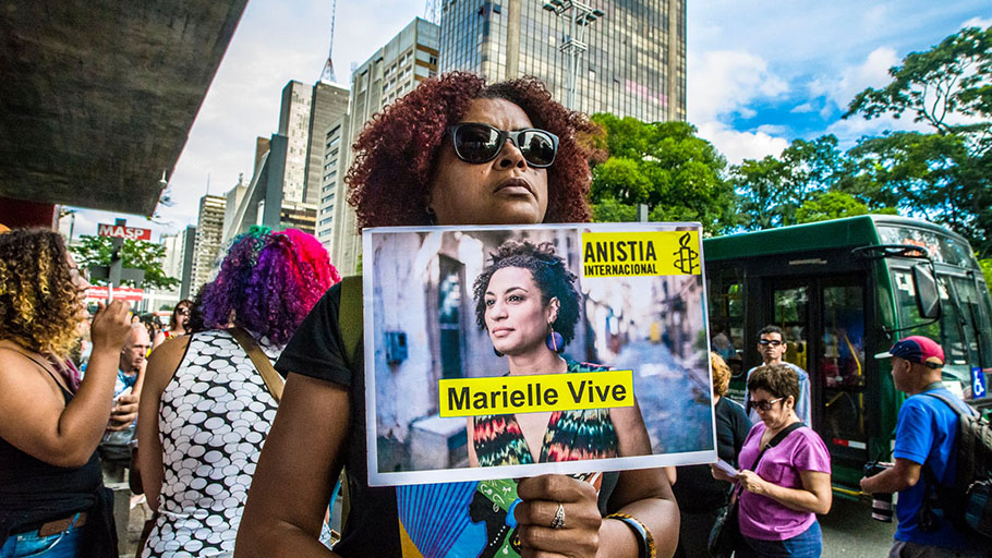 People gather in São Paulo on 14 April during a demonstration marking one month since Franco's murder.