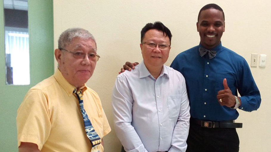 Elder William Allum Poon, an unidentified Chinese congregation member, and Pastor Brian Rochester of the Grace Chapel church, Port of Spain, Trinidad and Tobago.
