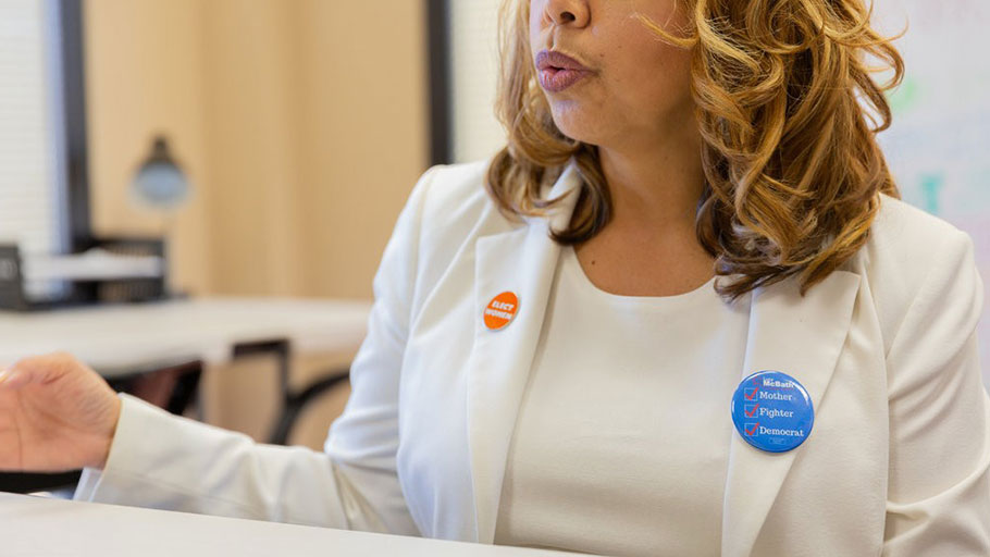 "Ms. McBath wears a pin that reads ""Mother. Fighter. Democrat."""