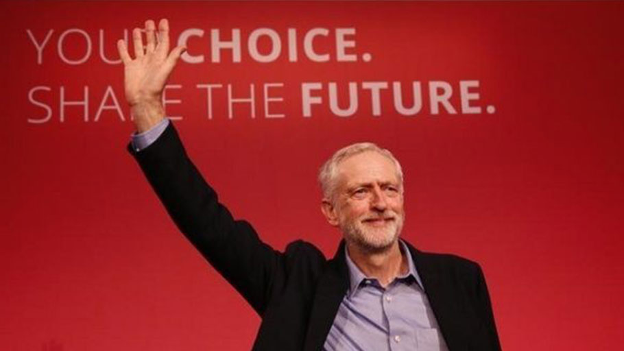Jeremy Corbyn waves after making his inaugural speech at the Queen Elizabeth Centre in central London, Sept. 12, 2015.