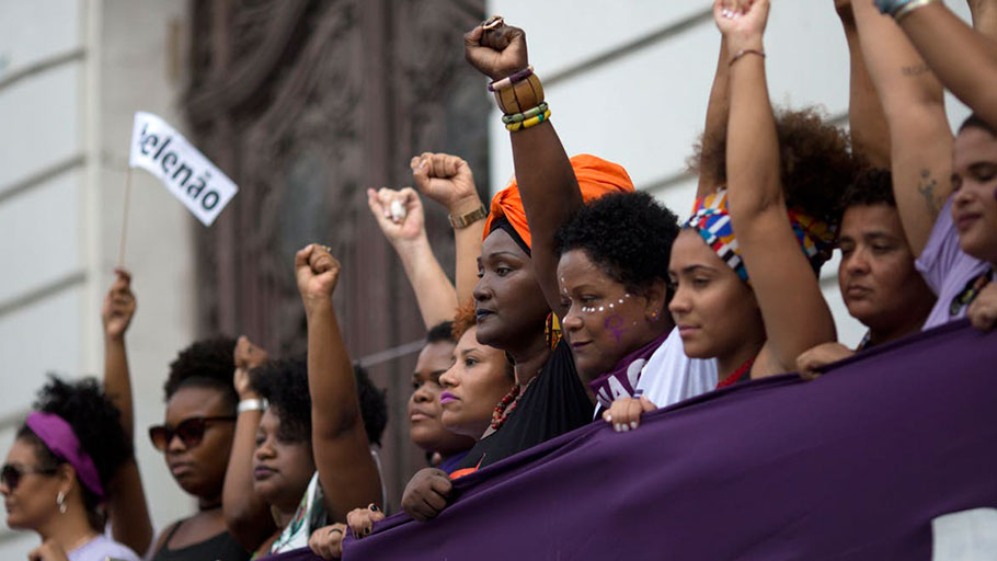 Black women in Brazil protest presidential frontrunner Jair Bolsonaro, who is known for his disparaging remarks about women, on Sept. 29, 2018.