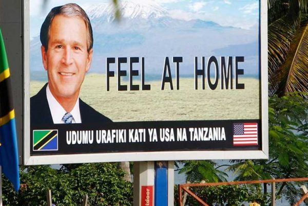 A sign promoting the visit of US president George W. Bush is seen in Dar es Salaam, February 2008.