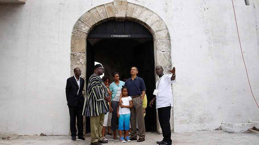 "U.S. president Barack Obama, Michelle Obama and their daughters Malia and Sasha stand at the ""Door of No Return"" during their visit to the Cape Coast Castle, Ghana, July 11, 2009"
