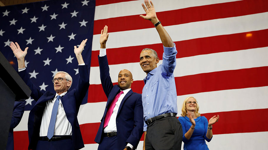 Barack Obama at a campaign rally in Milwaukee, Wisconsin, with governor-elect Tony Evers, Mandela Barnes and Sarah Godlewski on 26 October.