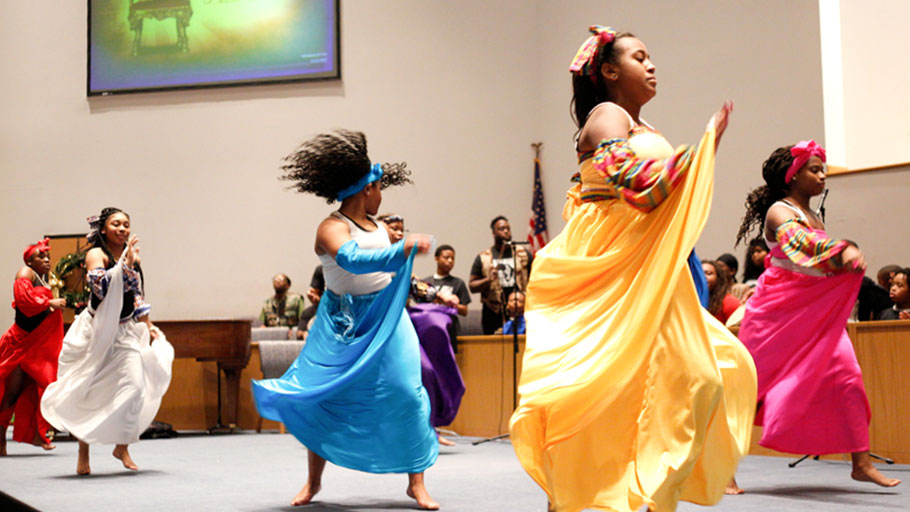 Dancers and drummers with the Harambee Youth Organization perform during a Kwanzaa celebration at New Bethel Baptist Church