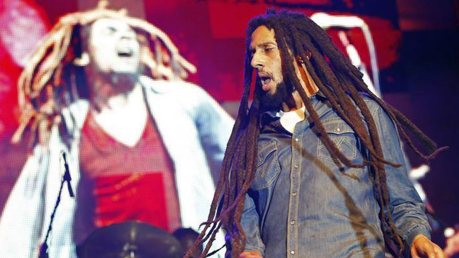 Julian Marley, son of late reggae icon Bob Marley, celebrates his father's 69th birthday at the National Stadium in Kingston, 2014.