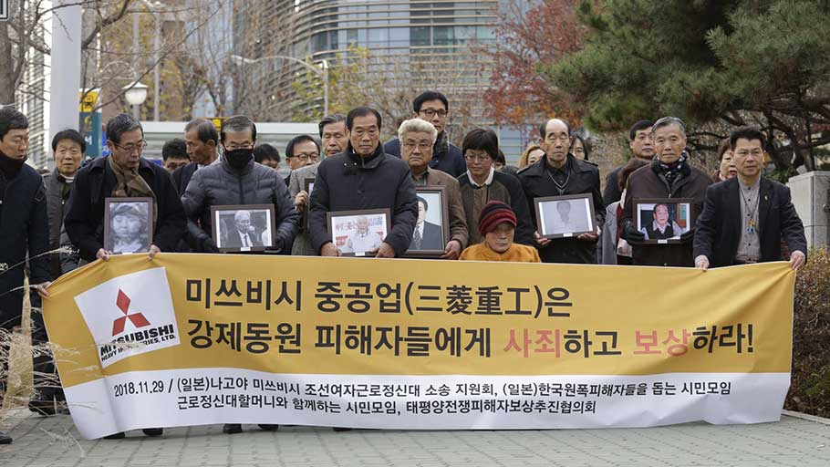 Victims of Japan's forced labour and their family members at the supreme court in Seoul. Photograph: Ahn Young-joon/AP