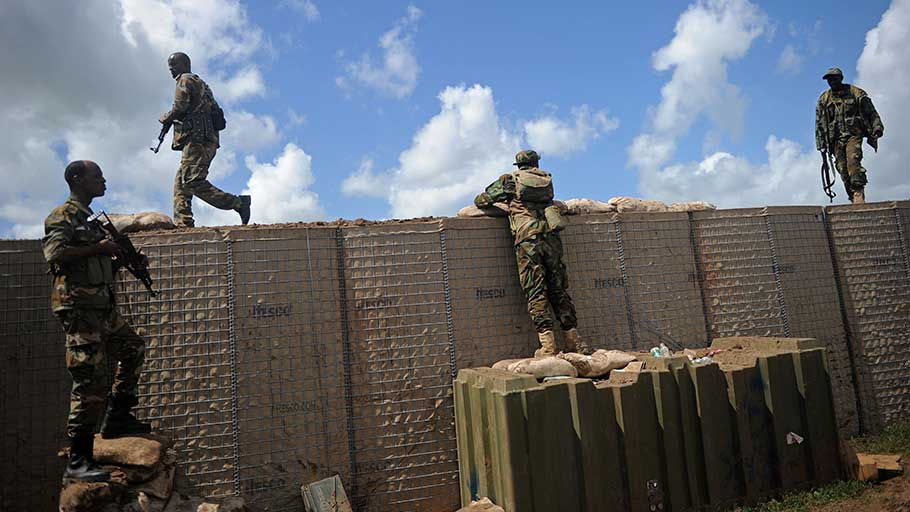 Somali soldiers are on patrol at Sanguuni military base, where an American special operations soldier was killed by a mortar attack on June 8, about 450 km south of Mogadishu, Somalia, on June 13, 2018. - More than 500 American forces are partnering with African Union Mission to Somalia (AMISOM) and Somali national security forces in counterterrorism operations, and have conducted frequent raids and drone strikes on Al-Shabaab training camps throughout Somalia.