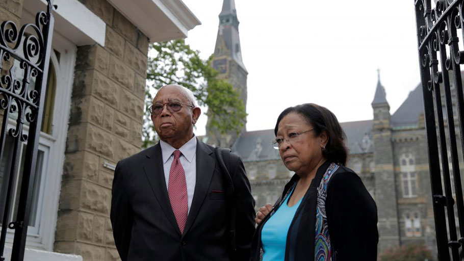 Left: Joe Stewart and Patricia Bayonne-Johnson, both descendants of people sold as slaves by Georgetown University, arrive to hear about moves aimed at acknowledging and encouraging dialogue about the Jesuit-run university's ties to slavery in Washington, D.C., on Sept. 1, 2016