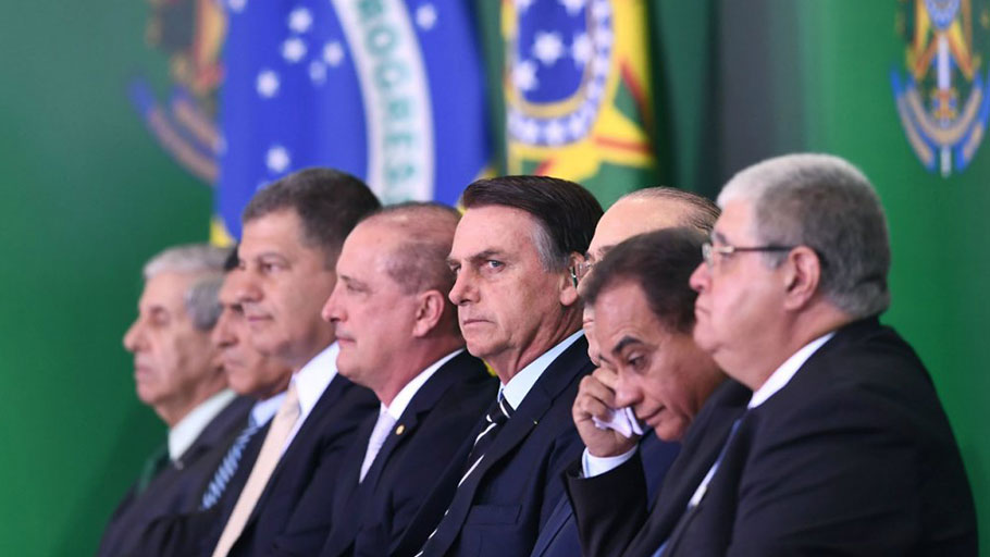 Bolsonaro targets Brazil minorities, rewards farm lobby on first day in office