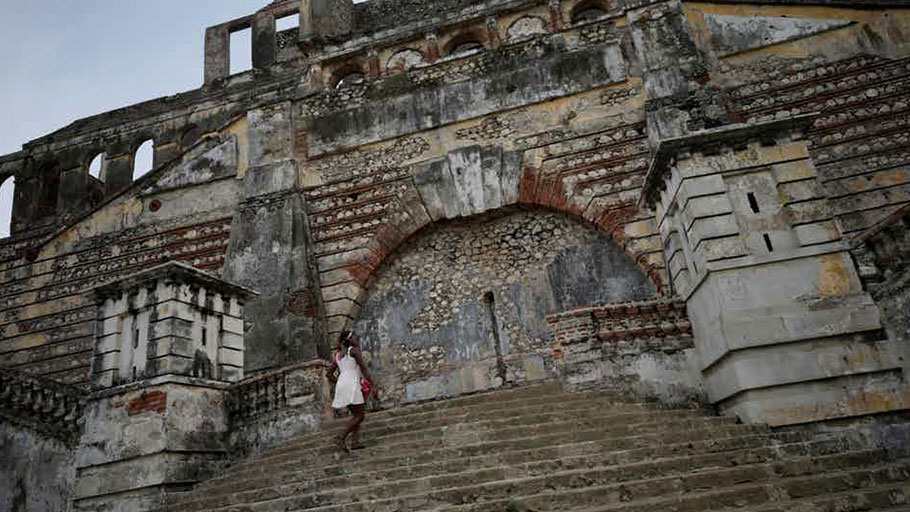 A woman climbs the stairs on the remains of Sans-Souci Palace in 2017.