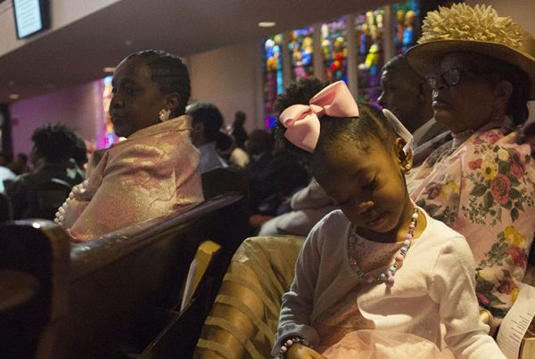 A child flips the pages of the Bible during Easter Sunday service at Wheat Street Baptist Church. Many of the church's members grew up going here their entire lives.