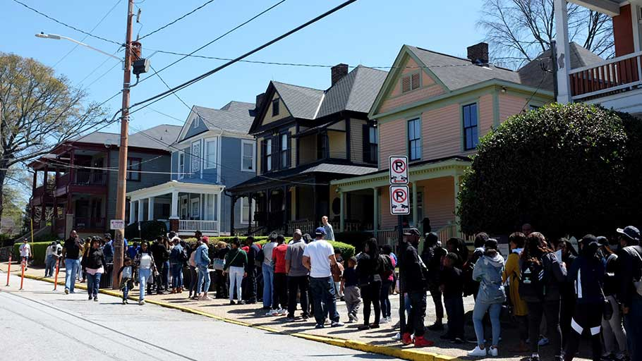 People line up to see the birth home of Martin Luther King. Jr. Nearly 1 million people a year visit this National Historic Site.