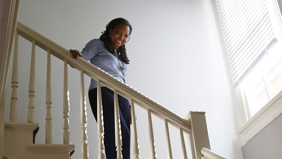 Mtamanika Youngblood, president of Sweet Auburn Works, stands on the stairs of her office on the same block as Martin Luther King Jr.'s birth home.