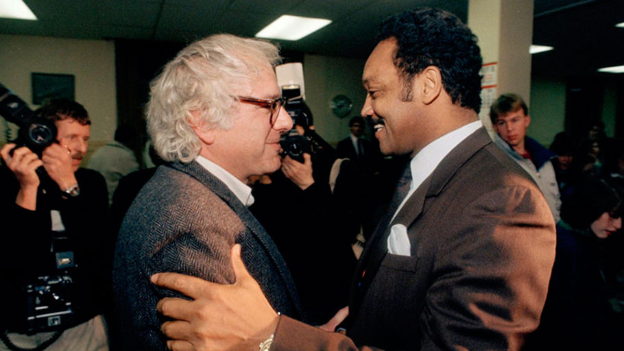 Sanders, the then-mayor of Burlington, Vermont, greets then-presidential candidate Jesse Jackson on Dec. 31, 1988. Supporters of Sanders' 2020 White House bid value his long history of progressive stances.