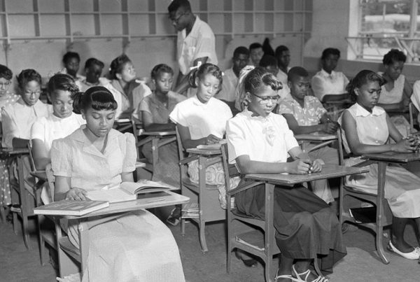Henrietta Hilton, front left, daughter of tenant farmer William Hilton, and her fellow students, are seen in their ninth grade classroom in Summerton, S.C., June 4, 1954.