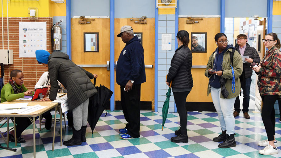 Voters register at a polling station in Manhattan, New York, on November 6, 2018.