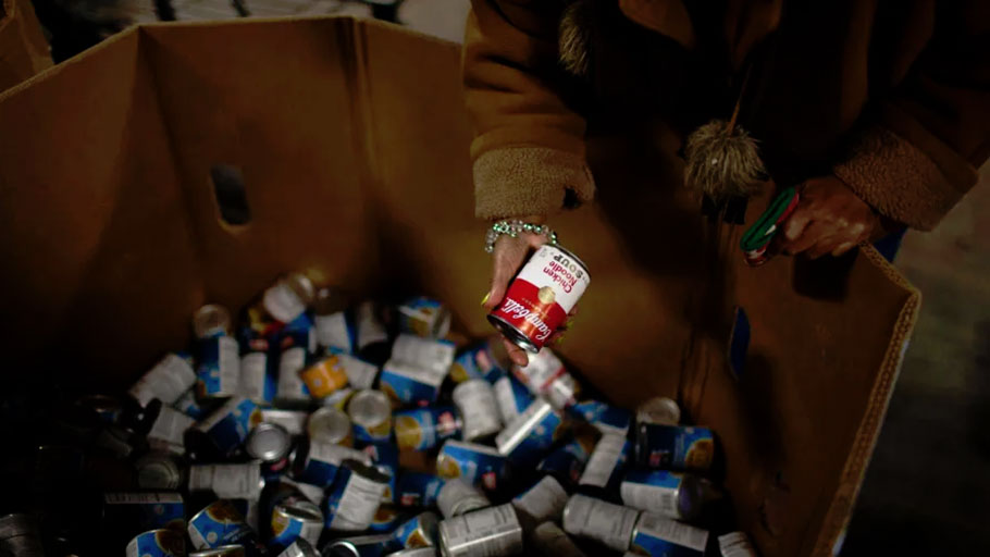 A woman shops for food at the St. Vincent de Paul food pantry in Indianapolis, Indiana.