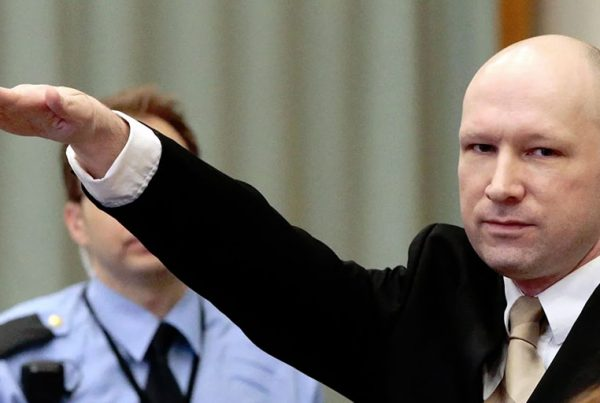Anders Breivik, who killed 77 people in bomb and gun attacks in 2011. gestures as he enters a courtroom in Skien, Norway, on March 15, 2016.
