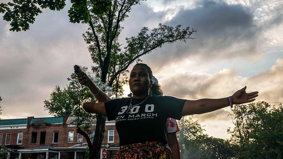 Erricka Bridgeford, the organizer of Baltimore Ceasefire, doing a spiritual cleanse at the site of a recent murder.