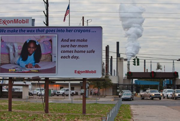"""The ExxonMobil refinery in Baton Rouge, Louisiana, is part of a large concentration of chemical and oil companies known as """"Cancer Alley."""" A new report finds that the fossil fuel industry is denying the reality of air and water pollution, or even shifting the blame for this pollution to those disadvantaged communities who are suffering the impacts of the industry's projects."""