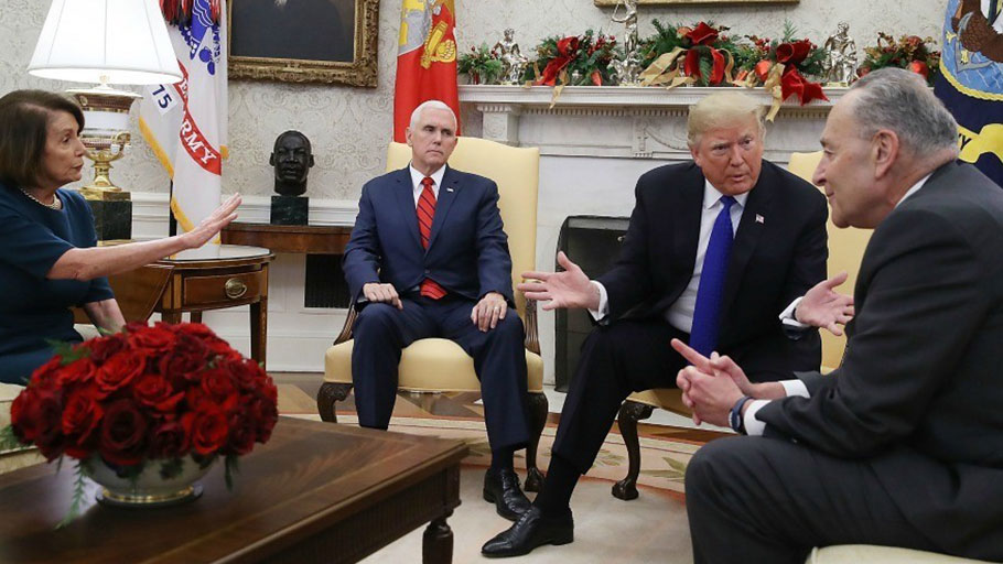 President Donald Trump talks about border security with Senate Minority Leader Chuck Schumer (D-N.Y.) and House Speaker Nancy Pelosi (D-Calif.) as Vice President Mike Pence sits nearby in the Oval Office on December 11, 2018 in Washington, D.C.