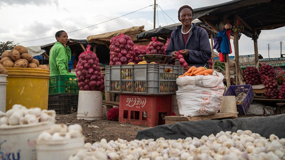 Eunice Ngima runs a small roadside stall selling garlic, onions, potatoes and other vegetables in Kiawara, Kenya