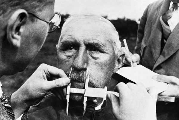 Nazi officials use calipers to measure an ethnic German's nose on January 1, 1941. The Nazis developed a pseudoscientific system of facial measurement that was supposedly a way of determining racial descent.