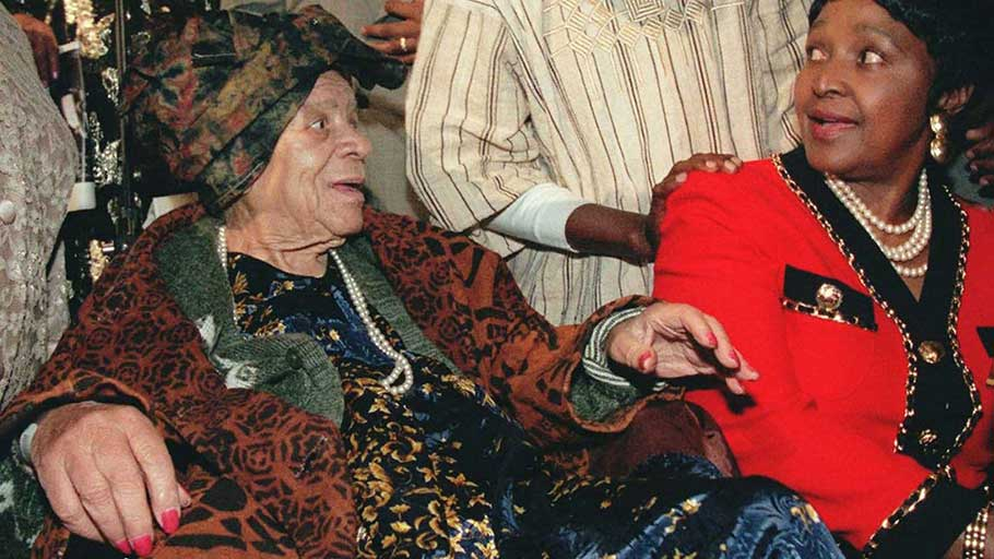 "Winnie Madikizela-Mandela, right, and Kwame Ture, the activist formerly known as Stokely Carmichael, attend a tribute to civil rights leader and black nationalist Audley ""Queen Mother"" Moore, left, in 1996 in New York."