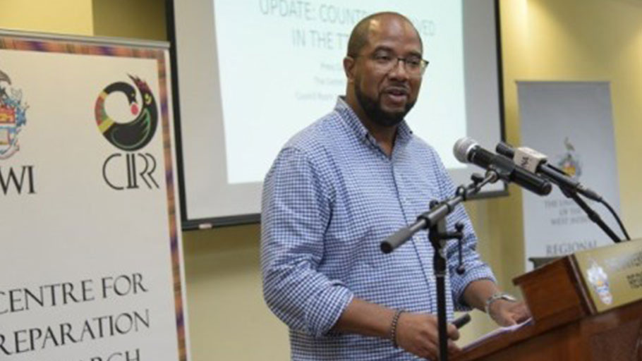Dr. Ahmed Reid giving his presentation at the press conference.
