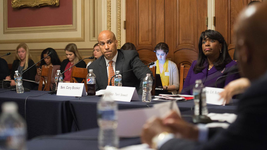 U.S. Sen. Cory Booker of New Jersey is among the 2020 Democratic presidential candidates who've traveled to the South to talk about voting rights. In this 2016 photo, Booker is seen discussing voting rights at the U.S. Capitol with Rep. Terri Sewell of Alabama and civil rights icon Rep. John Lewis of Georgia.
