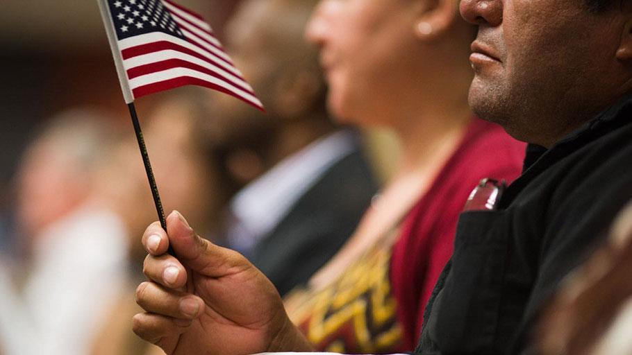 Detail of an American flag held by a newly naturalized citizen during a U.S. citizens naturalization ceremony in Atlanta on Aug. 10, 2016.