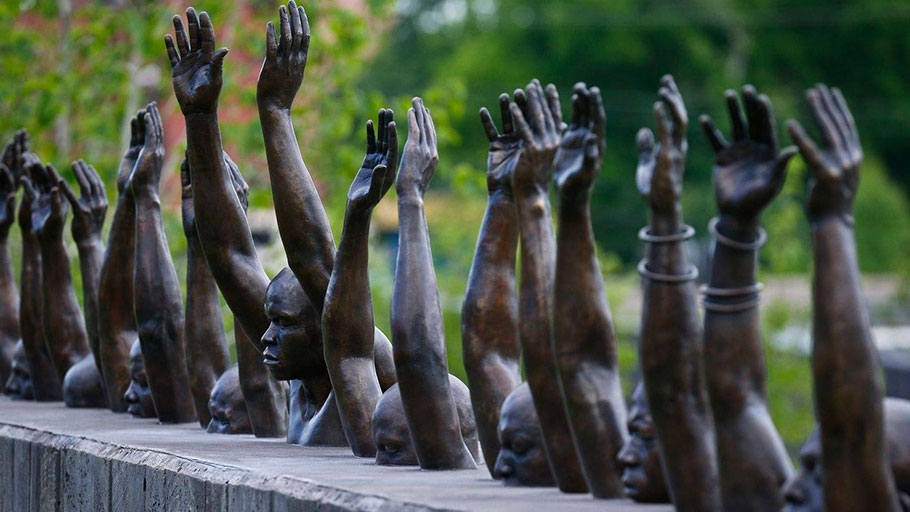 "The bronze statue called ""Raise Up"" at the National Memorial for Peace and Justice, a memorial to honor thousands of people killed in lynchings, on April 23, 2018, in Montgomery, Ala."