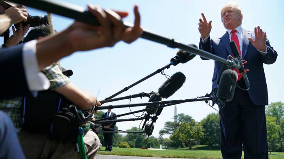President Donald Trump talks to journalists after returning to the White House July 30 in Washington, DC.
