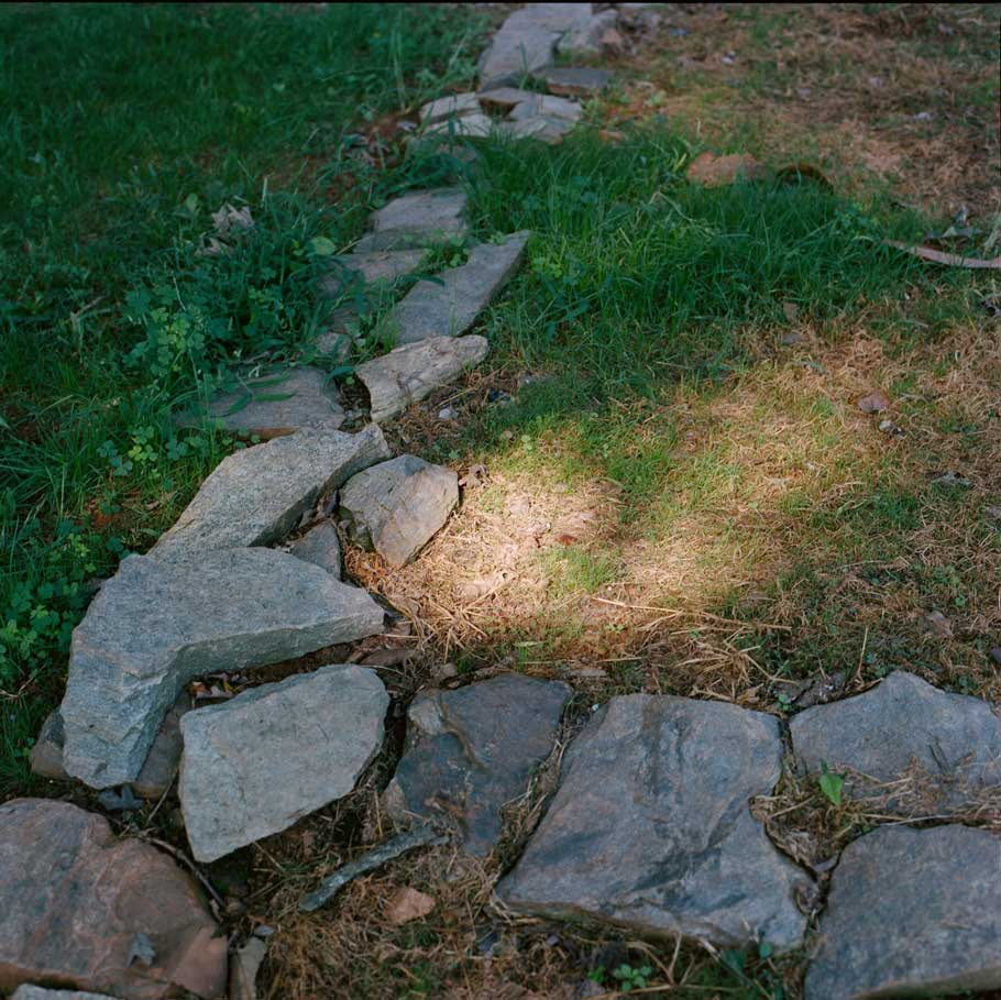 Rocks mark the location of the original house foundation at Highland.