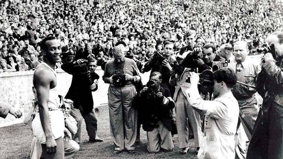 Defiant: Jesse Owens after winning the 100m at the Berlin Olympics, August 1936