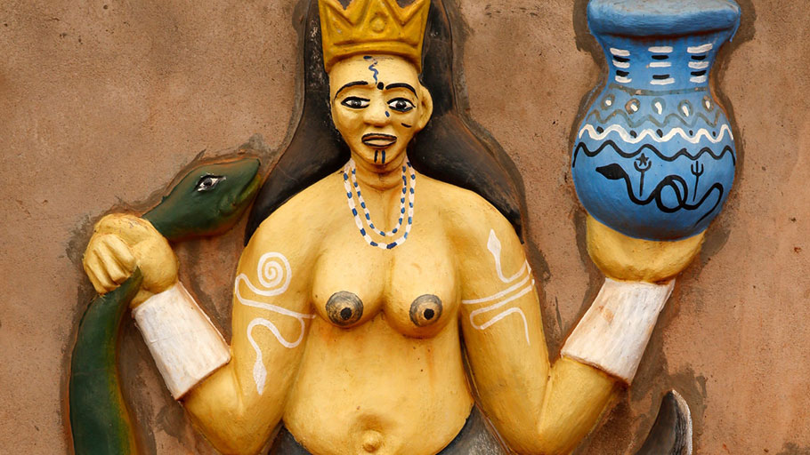 A relief sculpture of the goddess Mami Wata on the wall of a voodoo temple in Benin.