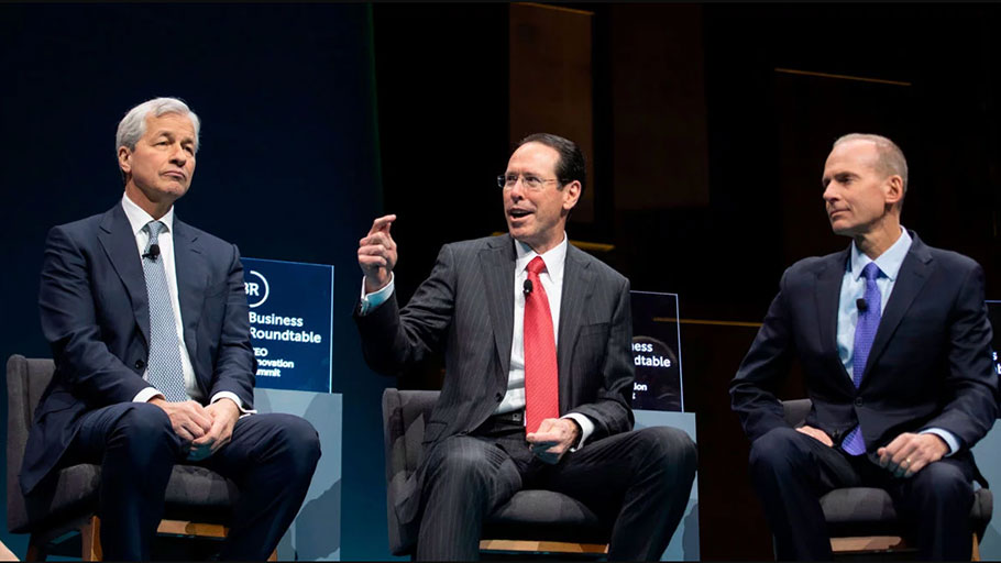JPMorgan Chase CEO Jamie Dimon, AT&T CEO Randall Stephenson and Boeing CEO Dennis Muilenberg speak during the Business Roundtable (BRT) CEO Innovation Summit in Washington, D.C., on December 6, 2018. Since its inception, BRT has been at the forefront of corporate resistance to pro-consumer, pro-union legislative efforts.