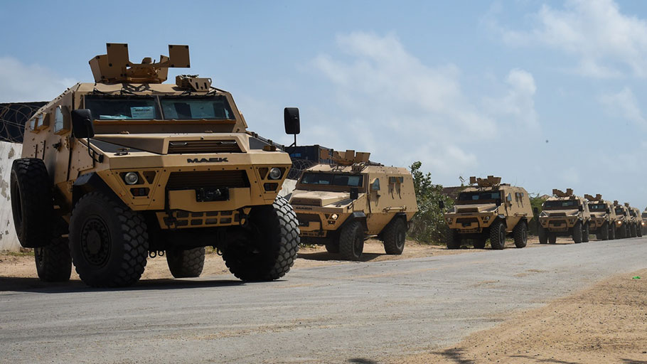 A convoy of AFRICOM's armored vehicles drive to the Uganda People's Defence Force compound in Mogadishu, Somalia