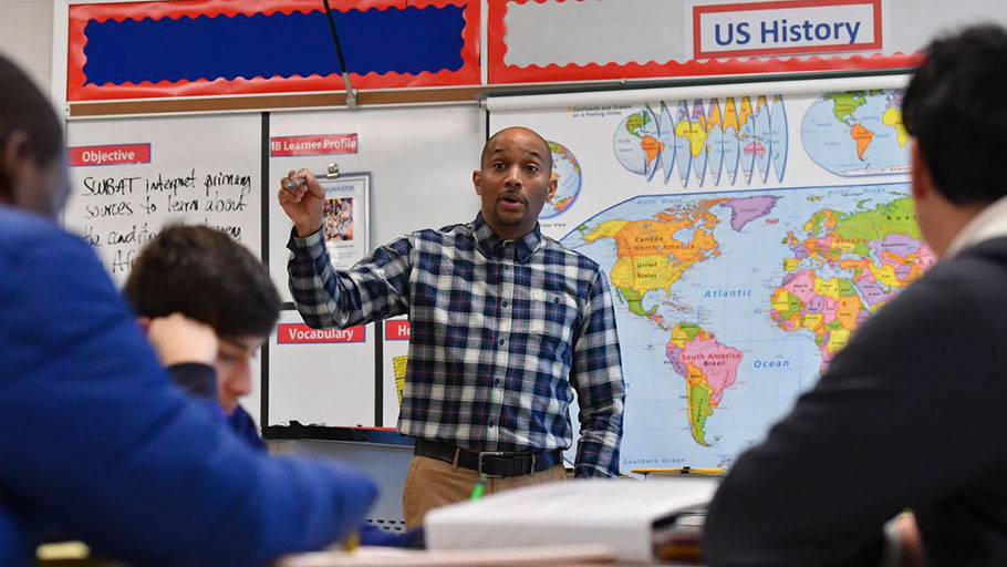 U.S. history teacher Philip Jackson teaches the history of slavery to his eighth-graders at Dr. Martin Luther King Jr. Middle School in Germantown, Md., in February.