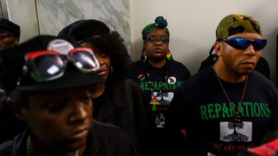 Activists line up June 19, 2019, for a House Judiciary Committee panel hearing on reparations for the descendants of slaves.