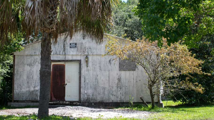 The Button, a former juke joint, sits in disrepair in the Snowden Community in Mount Pleasant, S.C. Such settlements were built by former slaves to be self-sufficient and to repel Ku Klux Klan attacks.