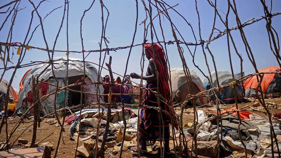A Somali woman walks in a camp for internally displaced people on Dec. 18, 2018, as hundreds of people fled from southern Somalia while the U.S. conducted airstrikes against the Shabab.