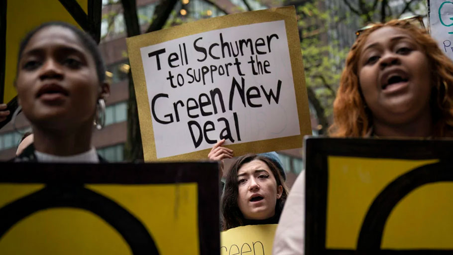 "Activists rally in support of proposed ""Green New Deal"" legislation outside of Senate Minority Leader Chuck Schumer's New York City office, April 30, 2019, in New York City."