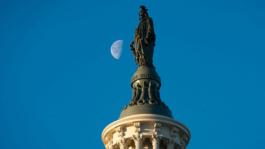 The Statue of Freedom atop the Capitol.