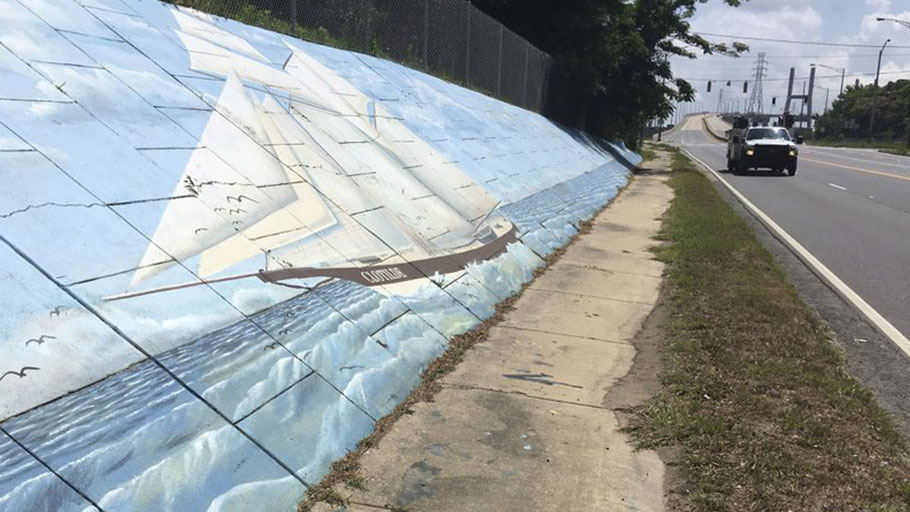 Mural of the slave ship Clotilda along Africatown Blvd