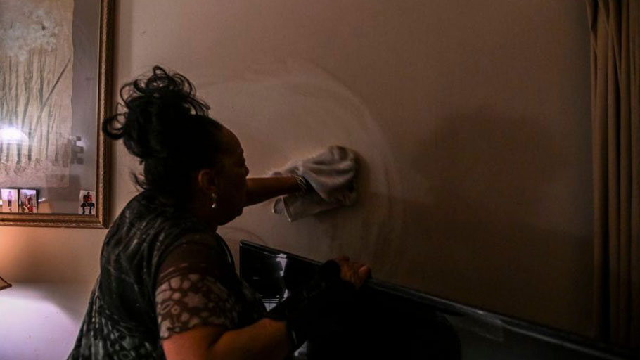 Willa Hatcher wipes traffic soot from the walls in her high-rise apartment that sits near I-81.